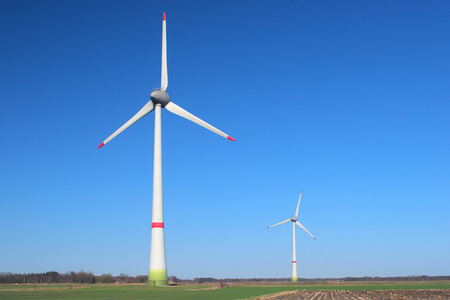 Two windmills on a cloudless, sunny day photo