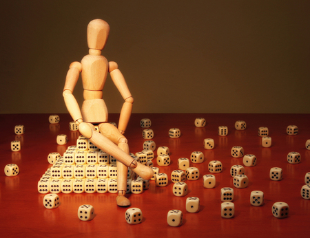 limelight: Doll and game dices symbolizing a project manager Stock Photo