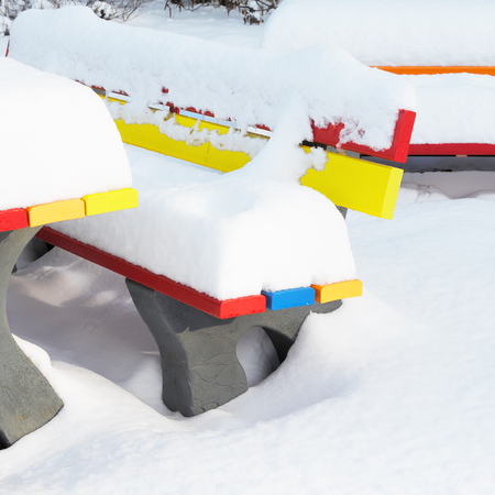 Colored outdoor benches in winter with a lot of snow photo