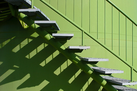 immobilize: Stairs with balustrade and shadows by a windmill  Stock Photo