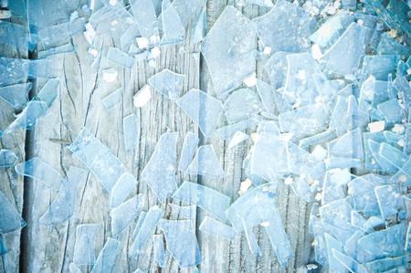 Blue Tinted Broken Glass On Old Wood Floor Фото со стока