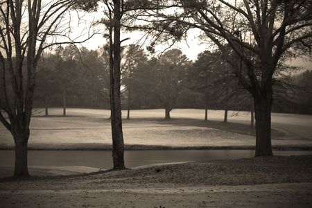 Lonely golf course on a rainey day photo