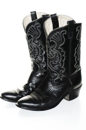 Black western boots over white