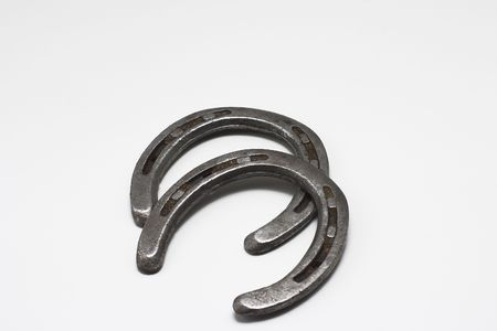 A pair of steel horseshoes well worn