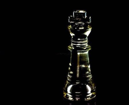 Glass chess king isolated on black in prism colors