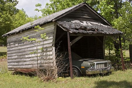 An abandon car in and old shed