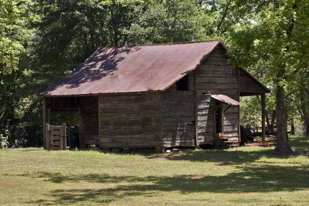 An old shed or barn in a clearing