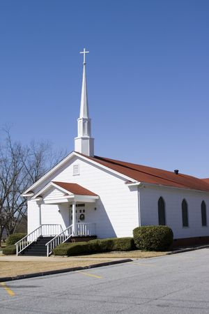 country church: Quiet rural small church with cross and steeple