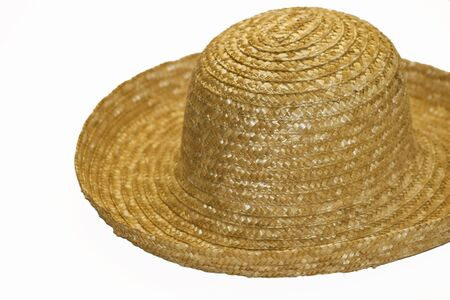 Single straw hat isolated over white for sun protection Фото со стока