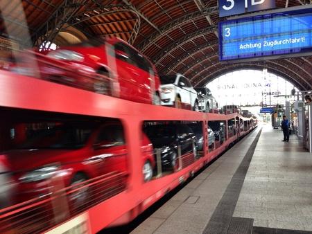 Motion blur of a car transport train as it speeds through station Stok Fotoğraf