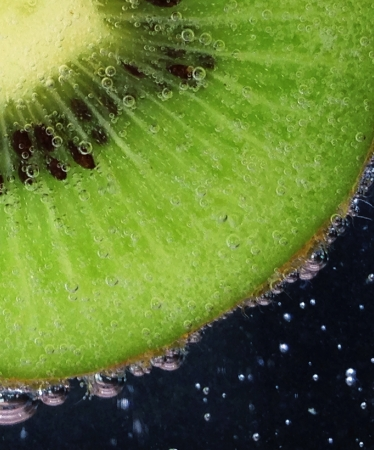 Macro of kiwi in bubbly water