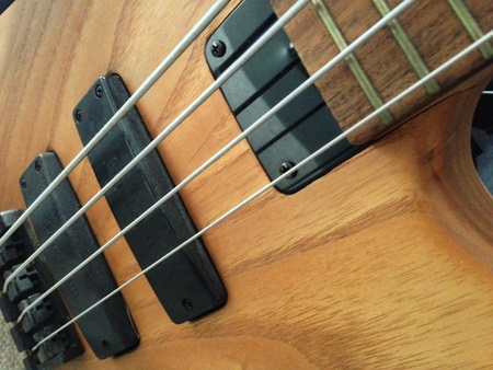 Natural wood bass guitar