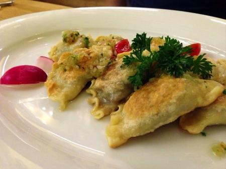 polish: Polish dumplings on a plate in Warsaw Stock Photo