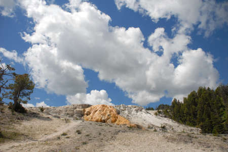 hot springs: Orange Hill Mammoth Hot Springs Yellowstone National Park Stock Photo
