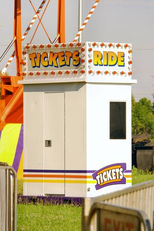 Ticket Booth sells tickets for rides at a rural carnival. photo