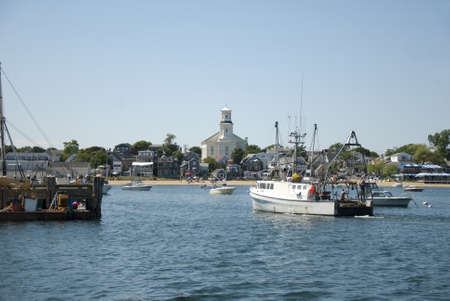 View of Provincetown Harbor, Massachusetts with fishing boats and town library.