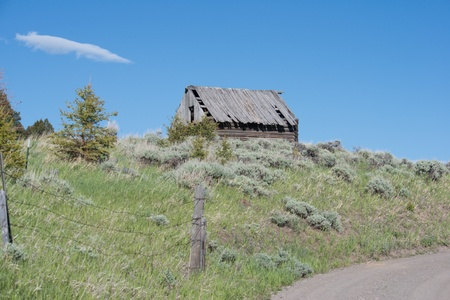 Abandoned shack beside a rural road in Gallatin County, Montana. photo