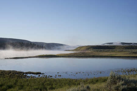 Mist rises from the Yellowstone River at Dawn  photo