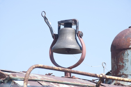 Old pull-type bell on an antique train engine. photo
