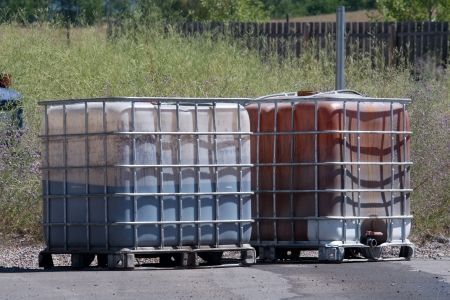 Leaking reinforced chemical storage containers present a potential environmental hazard. photo