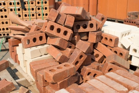 heap: Pallet of assorted bricks. Stock Photo
