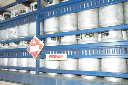 propane tank: Propane cylinders in a warehouse await transport on a truck.