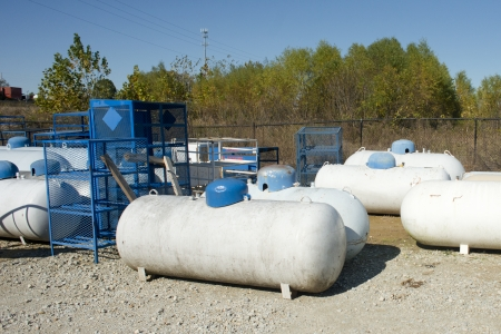 Propane tanks at a retail store with racks.
