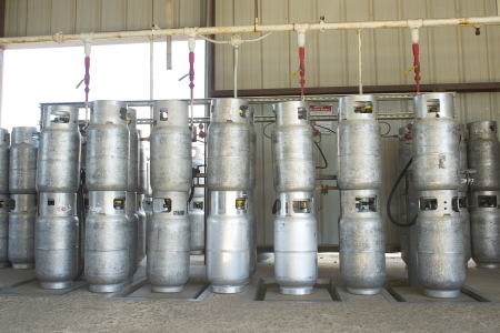 Propane cylinders in a warehouse await refillingand transport.