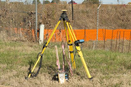 surveyors: Survey equipment at a construction site.