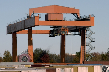 Railroad yard shipping container crane. Stock Photo