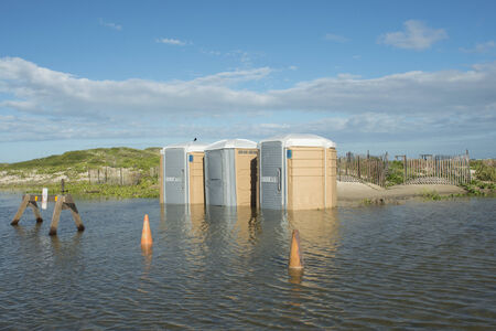 water sanitation: Flooded portable restrooms after a tropical storm at a beach in Texas  Stock Photo
