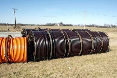 glass fiber: Fiber optic cable ready to be laid in a rural area with an old barn