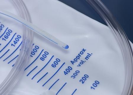 Close up photo of a urinary catheter with urine bag.