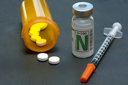 NPH insulin, syringe, and medication for the control of diabetes.