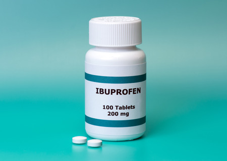 Ibuprofen bottle and tablets on aqua background   Label is not real
