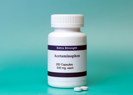 reliever: Acetaminophen bottle and pills on aqua background.   Label is not real  Stock Photo