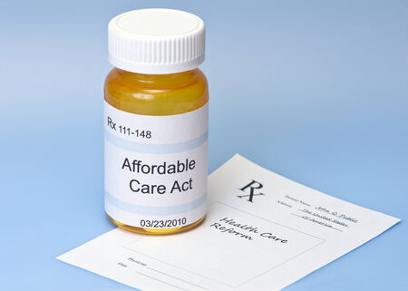 Affordable Care Act prescription bottle on blue with prescription for health care reform