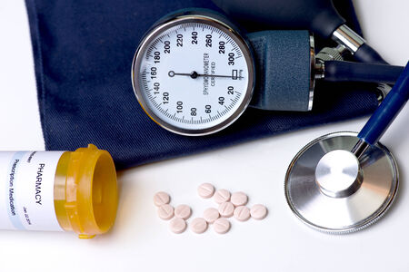 Blood pressure medication, cuff, and stethescope. Stock Photo - 26959192
