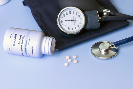 Blood pressure medication, cuff, and stethescope. Stock Photo - 26959209