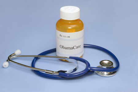 ObamaCare prescription bottle with stethoscope.