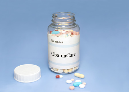 federal: ObamaCare assorted pills on blue . Stock Photo