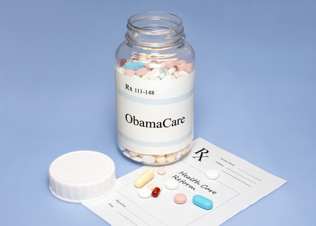 ObamaCare assorted pills on blue with prescription for healthcare reform. photo