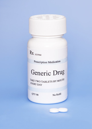 generic: Generic drug prescription bottle on blue . Stock Photo