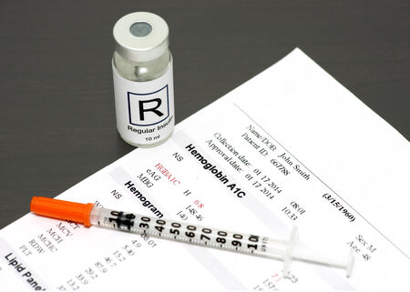 Hemoglobin A1C report with insulin vial and syringe. Stock Photo