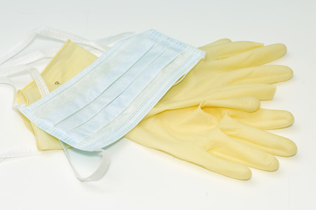 Mask and gloves for the prevention of disease transmission. Stock Photo