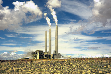 coal fired: Coal-fired plant smokestacks in the Arizona desert.
