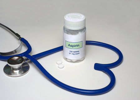 Low dose aspirin in a heart shaped stethoscope.