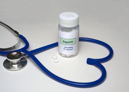 aspirin: Low dose aspirin in a heart shaped stethoscope.