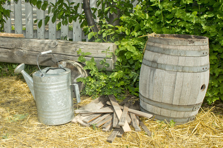 Garden stakes with watering can and barrel. Stock Photo
