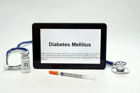 Tablet computer showing diabetes fact sheet, stethescope, insulin vial, and syringe. Stock fotó